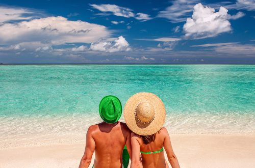 couple-on-a-beach-at-maldives-PS6C3MA.jpg